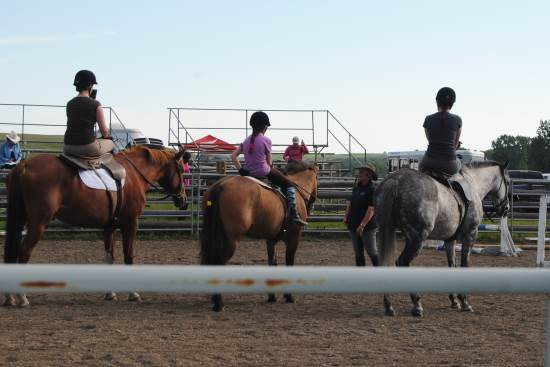 2014 July 10 4 Glynis Barnes teaching in the sand ring Michelle, Caitlyn and Cait.jpg